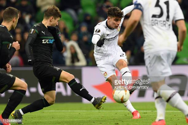 FK Krasnodar's Russian midfielder Dmitriy Stotskiy and Leverkusen's German midfielder Kai Havertz vie for the ball during the UEFA Europa League...