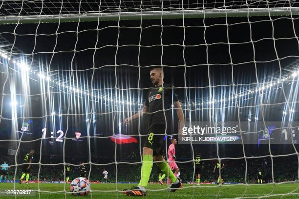 Krasnodar's Russian midfielder Yuri Gazinskiy takes the ball out of his goal during the UEFA Champions League Group E second-leg football match...