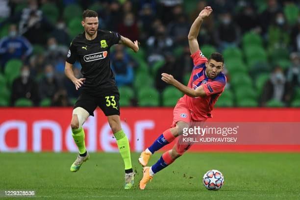 Krasnodar's Swedish forward Marcus Berg and Chelsea's Croatian midfielder Mateo Kovacic vie for the ball during the UEFA Champions League football...