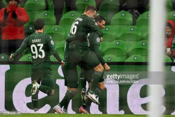 Krasnodar's Swedish forward Marcus Berg celebrates with teammates after scoring the opening goal during the UEFA Champions League football match...