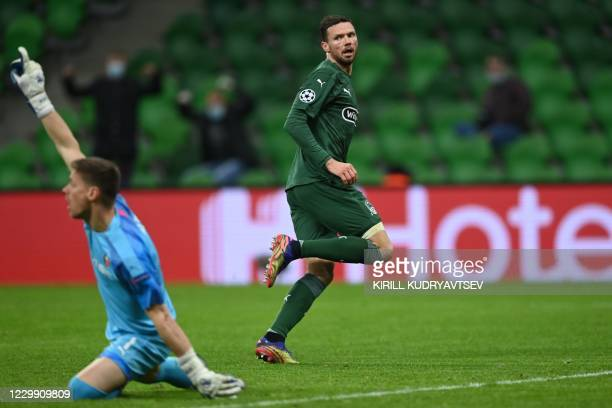 Krasnodar's Swedish forward Marcus Berg reacts after scoring the opening goal during the UEFA Champions League football match between FK Krasnodar...