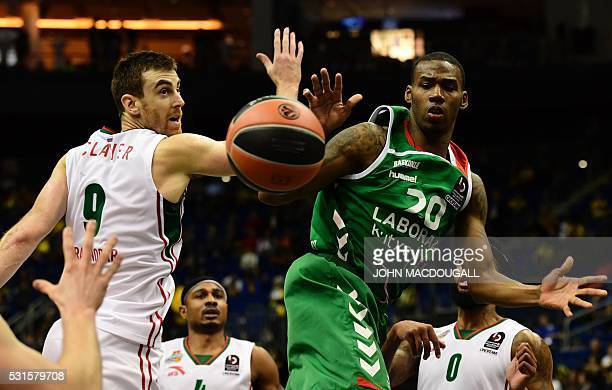 Krasnodar's Victor Claver tries to block Laboral's Darius Adams during the basketball match for third place Lokomotiv Kuban Krasnodar vs Laboral...