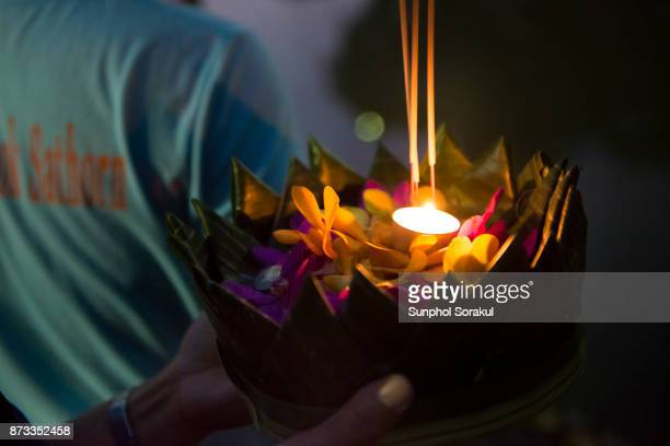 Krathong, A container made of folded leaves carrying flowers, candle and incense sticks