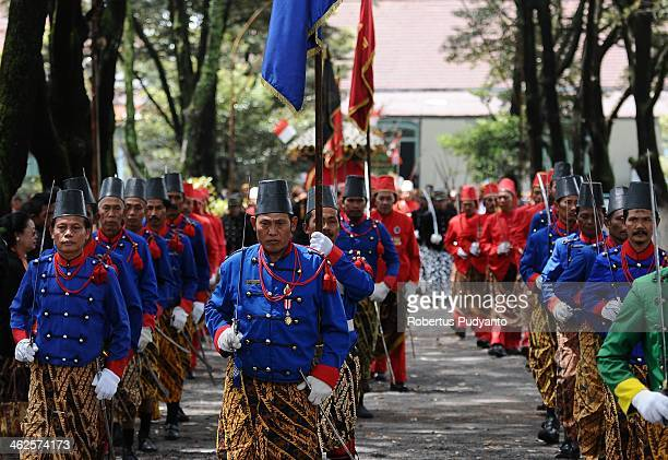 Kraton's Surakarta Royal Guards prepare to guard the Gunungan offering during Grebeg Maulud at Kemandungan Palace on January 14 2014 in Solo City...