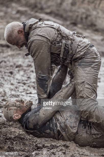 krav maga military muddy fighting duo - army training stock pictures, royalty-free photos & images