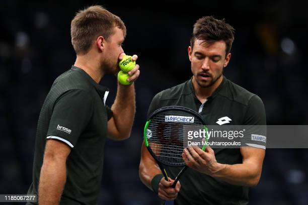 Krawietz and Andreas Mies of Germany speak as the play against Kevin PierreHugues Herbert and Nicolas Mahut of France in their Mens Doubles Semi...
