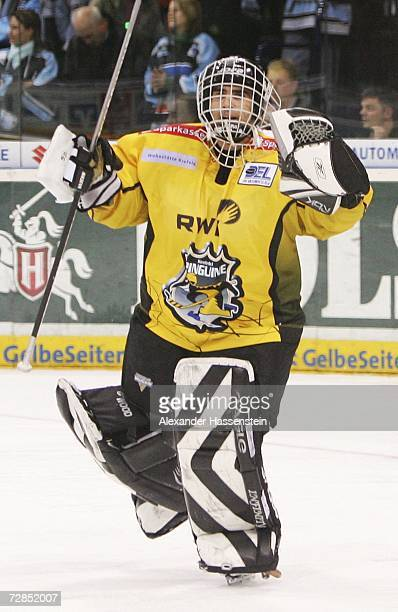 Krefelds goalminder Reto Pavoni celebrates winning the match after the last penalty during the DEL Bundesliga game between the Hamburg Freezers and...