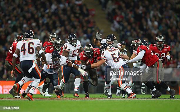 Kregg Lumpkin of the Tampa Bay Buccaneers attempts to break through the Chicago Bears defense during the NFL International Series match between...