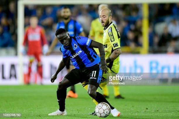 Krepin Diatta forward of Club Brugge is challenged by Steve De Ridder forward of Lokeren during the Jupiler Pro League match between Club Brugge and...