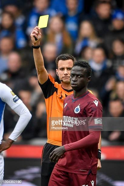 Krepin Diatta forward of Club Brugge receives a yellow card during the Jupiler Pro League match between KRC Genk and Club Brugge KV on March 01 2020...