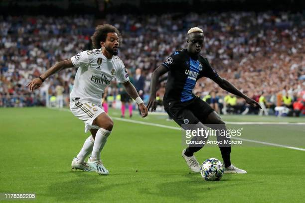 Krepin Diatta of Club Brugge battles for possession with Marcelo of Real Madrid during the UEFA Champions League group A match between Real Madrid...