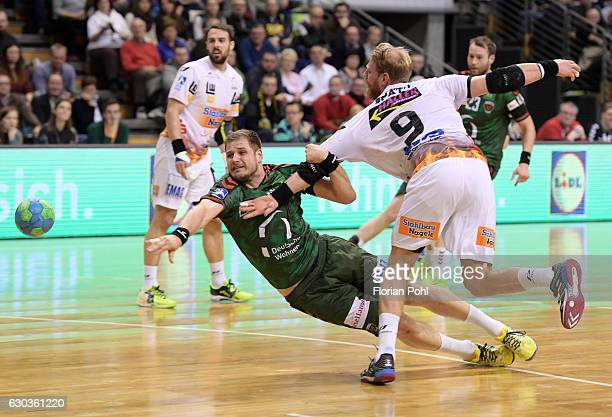 Kresimir Kozina of Fuechse Berlin and Manuel Spaeth of Frisch Auf Goeppingen during the game between Fuechse Berlin and Frisch Auf Goeppingen on...