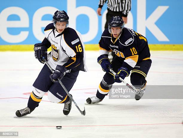 Kriistian Nakyva fights for the puc whith Martin Thrnberg during the IIHF Champions Hockey League match between HV 71 Joenkoeping and Espoo Blues on...