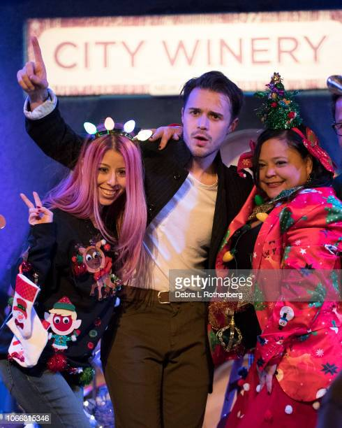 Kris Allen is joined by fans during an impromptu ugly Christmas shirt contest on stage at City Winery on November 28 2018 in New York City