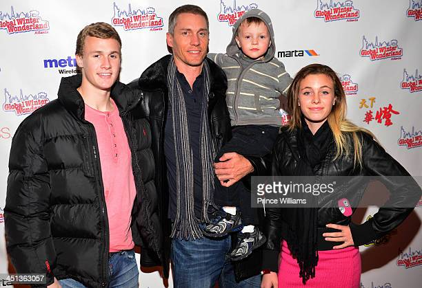 Kris Benson and his family attend the Global Winter Wonderland ribbon cutting ceremony and grand opening at Turner Field on November 21 2013 in...