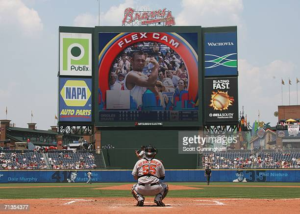Kris Benson of the Baltimore Orioles warms up with his catcher Ramon Hernandez for the game against the Atlanta Braves at Turner Field on July 2 2006...