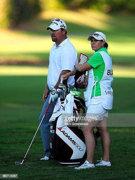 Kris Blanks looks over a shot with caddie AJ Eathorne during the first round of the Sony Open at Waialae Country Club on January 14 2010 in Honolulu...