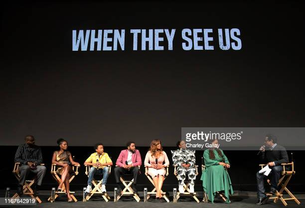 Kris Bowers Marsha Stephanie Blake Asante Blackk Jharrel Jerome Niecy Nash Aunjanue Ellis Ava DuVernay and JJ Abrams speak onstage at Netflix's When...