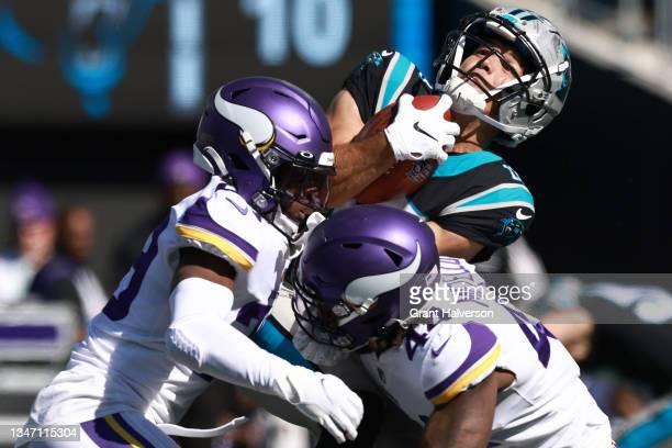 Kris Boyd and Josh Metellus of the Minnesota Vikings tackle Alex Erickson of the Carolina Panthers during the third quarter at Bank of America...