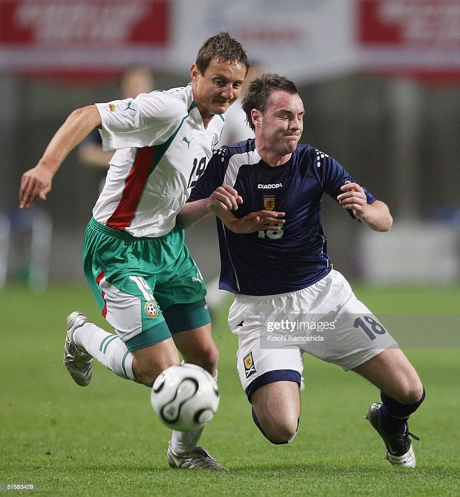 Kris Boyd of Scotland and Asen Karaslavov of Bulgaria battle for the ball during the Kirin Cup Soccer 2006 between Scotland and Bulgaria, at the Kobe Wing Stadium on May 11, 2006 in Kobe, Japan.
