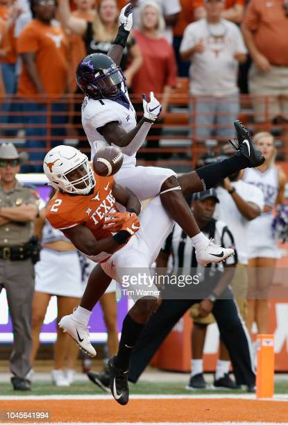 Kris Boyd of the Texas Longhorns breaks up a pass intended for Jalen Reagor of the TCU Horned Frogs in the second half at Darrell K RoyalTexas...
