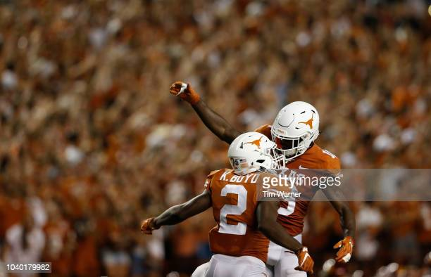Kris Boyd of the Texas Longhorns celebrates with Davante Davis after an interception in the first half against the USC Trojans at Darrell K...
