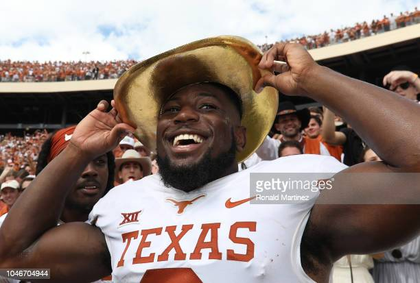 Kris Boyd of the Texas Longhorns wears the Golden Hat trophy after a win against the Oklahoma Sooners in the 2018 ATT Red River Showdown at Cotton...