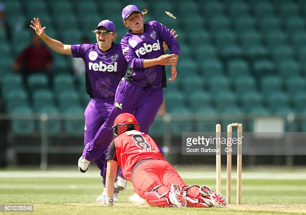 Kris Britt of the Renegades dives back to make her ground to avoid being run out during the Women's Big Bash League match between the Hobart...
