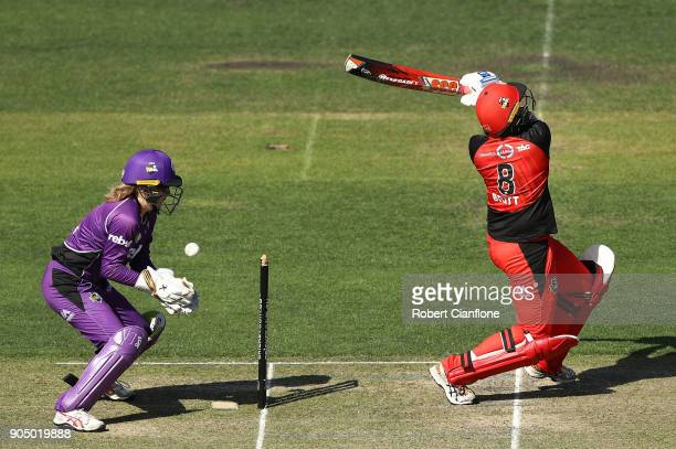 Kris Britt of the Renegades is caught behind by Georgia Redmayne of the Hurricanes during the Women's Big Bash League match between the Hobart...