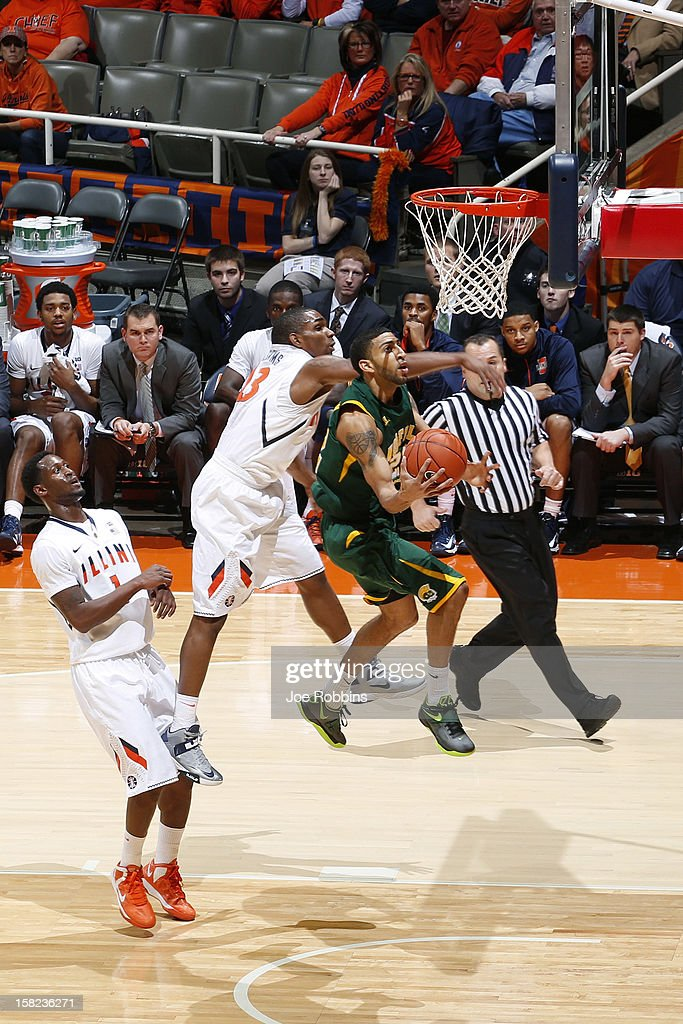 Kris Brown #22 of the Norfolk State Spartans drives to the basket against Tracy Abrams #13 of the Illinois Fighting Illini during the game at Assembly Hall on December 11, 2012 in Champaign, Illinois. Illinois won 64-54.