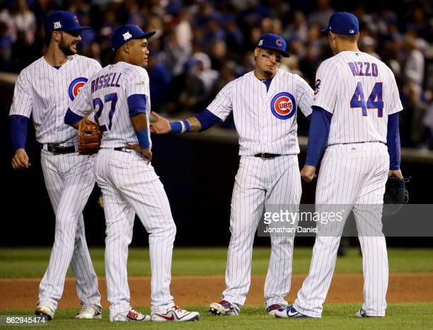 Kris Bryant Addison Russell Javier Baez and Anthony Rizzo of the Chicago Cubs meet during a pitching change in the seventh inning against the Los...