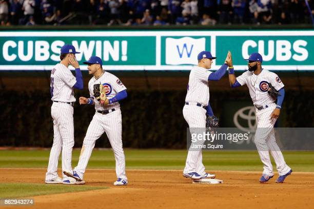 Kris Bryant Albert Almora Jr #5 Anthony Rizzo and Jason Heyward of the Chicago Cubs celebrate defeating the Los Angeles Dodgers 32 in game four of...
