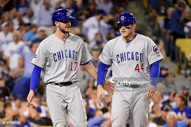 Kris Bryant and Anthony Rizzo of the Chicago Cubs celebrate after they score a run in the sixth inning against the Los Angeles Dodgers in game four...