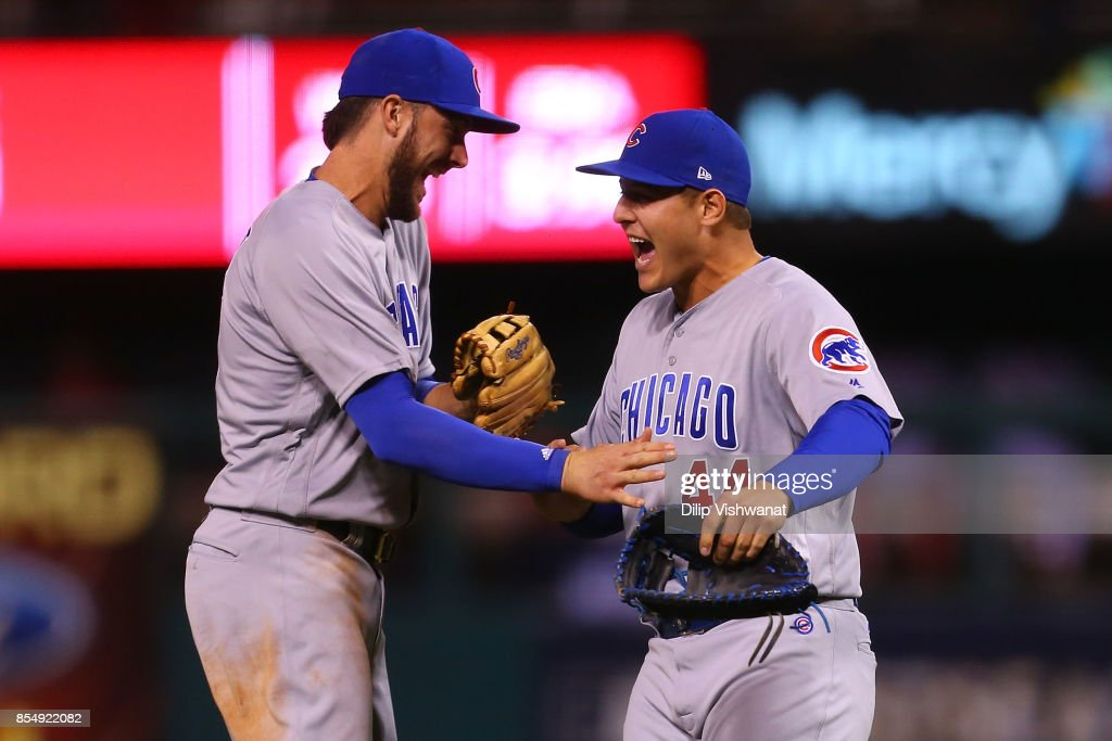 Kris Bryant #17 and Anthony Rizzo #44 of the Chicago Cubs celebrate after winning the National League Central title against the St. Louis Cardinals at Busch Stadium on September 27, 2017 in St. Louis, Missouri.