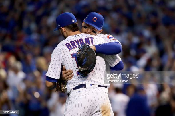 Kris Bryant and Anthony Rizzo of the Chicago Cubs celebrate after beating the Washington Nationals 21 in game three of the National League Division...