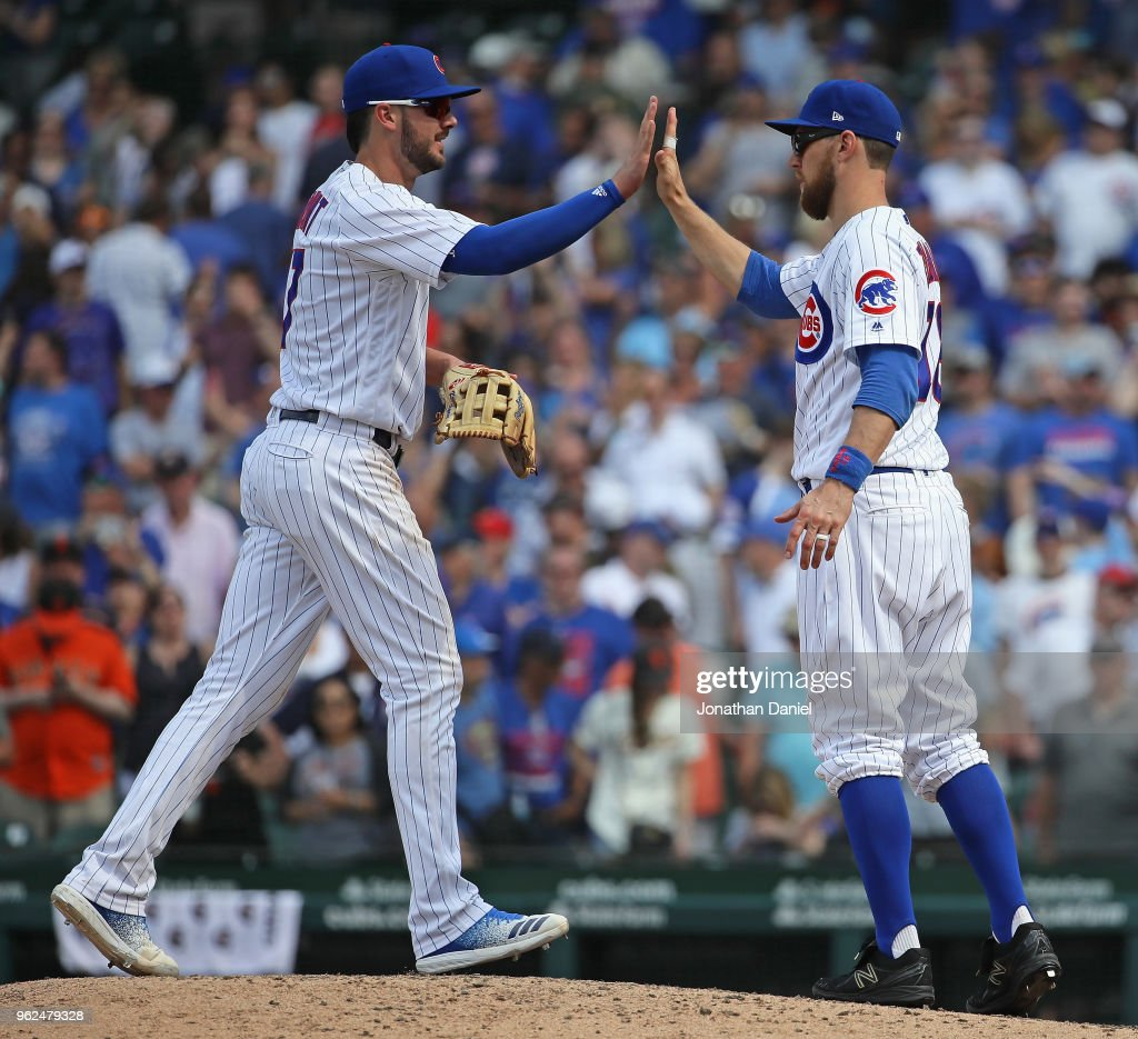 Kris Bryant #19 (L) and Ben Zobrist #18 of the Chicago Cubs celebrate a win against the San Francisco Giants at Wrigley Field on May 25, 2018 in Chicago, Illinois. The Cubs defeated the Giants 6-2.