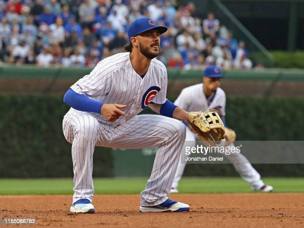 Kris Bryant and Javier Baez of the Chicago Cubs man their positions against the St Louis Cardinals at Wrigley Field on June 09 2019 in Chicago...