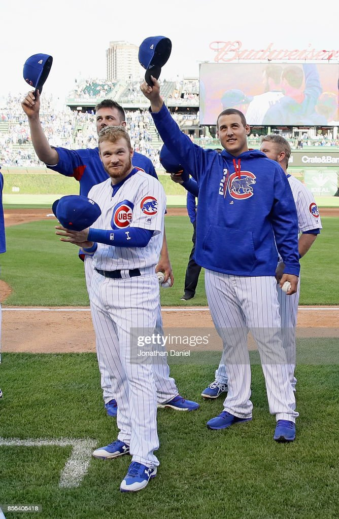 Kris Bryant #17, Ian Happ #8 and Anthony Rizzo #44 of the Chicago Cubs salute the fans after the last regular season game against the Cincinnati Reds at Wrigley Field on October 1, 2017 in Chicago, Illinois. The Reds defeated the Cubs 3-1.
