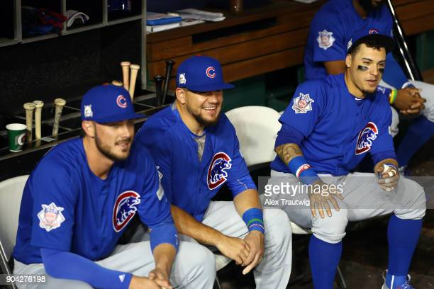 Kris Bryant Kyle Schwarber and Javier Baez of the Chicago Cubs sit in the dugout prior to Game 1 of the National League Division Series against the...