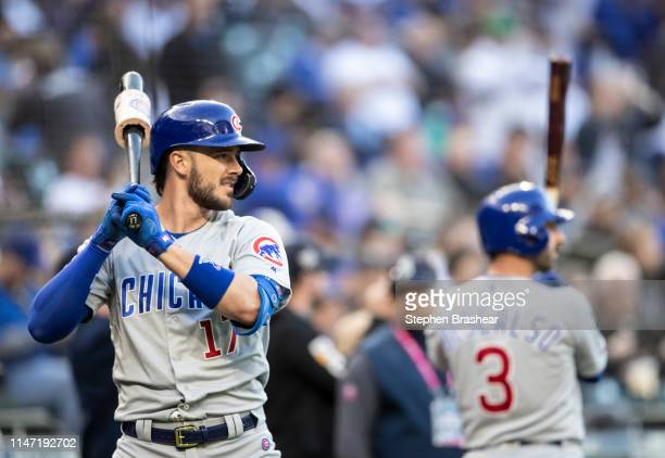 Kris Bryant of the Chicago Cubs and Daniel Descalso of the Chicago Cubs stand warm up with bats before the first pitch of a game against the Seattle...