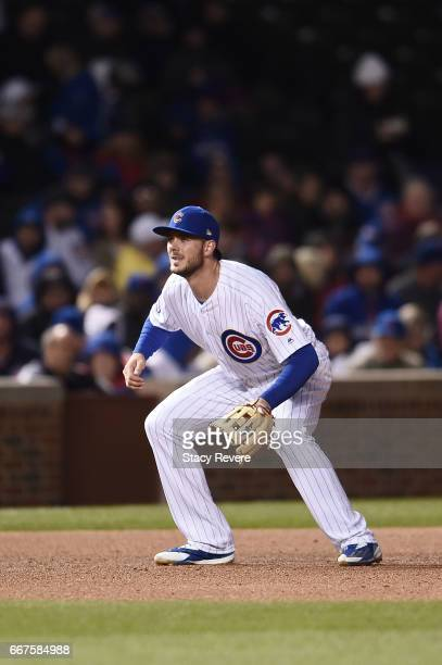 Kris Bryant of the Chicago Cubs anticipates a pitch during a game against the Los Angeles Dodgers at Wrigley Field on April 10 2017 in Chicago...