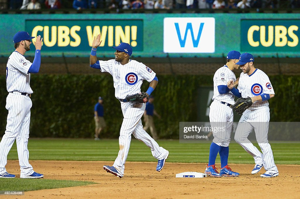 Kris Bryant #17 of the Chicago Cubs, Austin Jackson #27 of the Chicago Cubs, Javier Baez #9 of the Chicago Cubs, and Chris Denorfia #15 of the Chicago Cubs celebrate defeating the St. Louis Cardinals 8 to 6 in game three of the National League Division Series at Wrigley Field on October 12, 2015 in Chicago, Illinois.