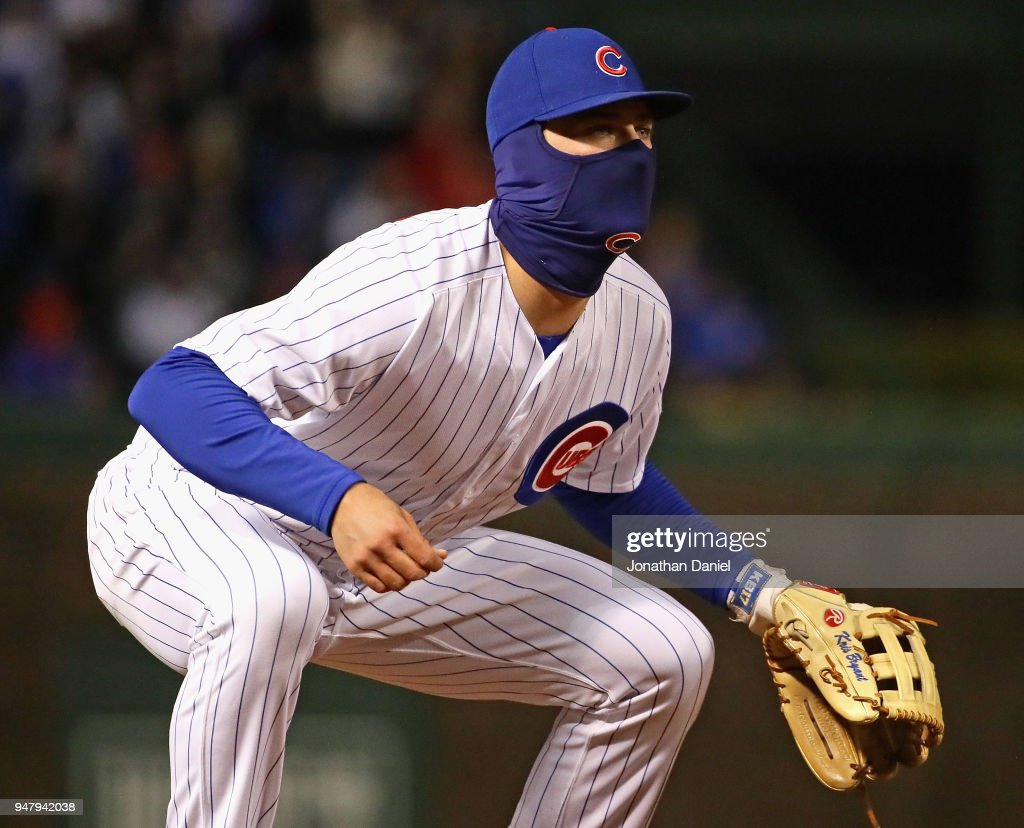 Kris Bryant #17 of the Chicago Cubs, bundled up forthe cold, mans third base against the St. Louis Cardinals at Wrigley Field on April 17, 2018 in Chicago, Illinois.
