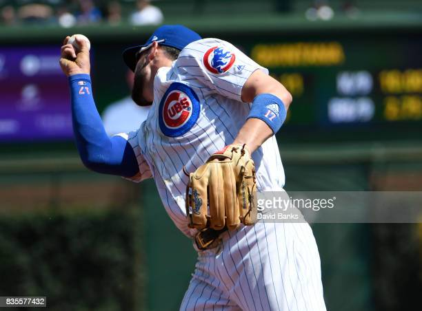 Kris Bryant of the Chicago Cubs catches a line drive hit by Kevin Pillar of the Toronto Blue Jays during the second inning on August 19 2017 at...