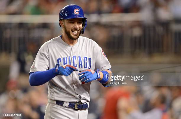 Kris Bryant of the Chicago Cubs celebrates after hitting a home run in the eighth inning against the Washington Nationals at Nationals Park on May 17...
