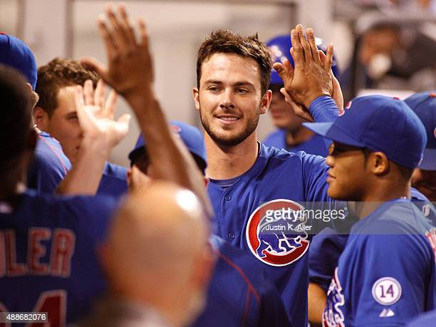 Kris Bryant of the Chicago Cubs celebrates after scoring on a sacrifice bunt to catcher in the sixth inning during the game against the Pittsburgh...
