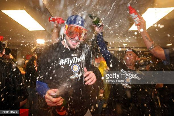 Kris Bryant of the Chicago Cubs celebrates in the clubhouse with teammates after defeating the Washington Nationals 98 in game five of the National...