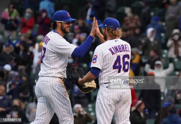 Kris Bryant of the Chicago Cubs celebrates with Craig Kimbrel after their team's win over the Cincinnati Reds at Wrigley Field on May 28, 2021 in...