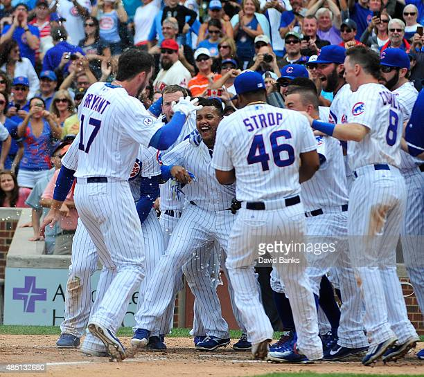 Kris Bryant of the Chicago Cubs celebrates with his teammates his walkoff home run against the Cleveland Indians during the ninth inning on August 24...