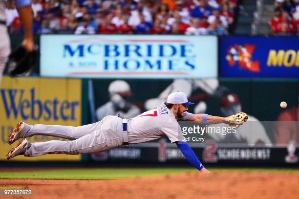 Kris Bryant of the Chicago Cubs dives but is unable to field a ball hit by Jack Flaherty of the St Louis Cardinals during the third inning at Busch...